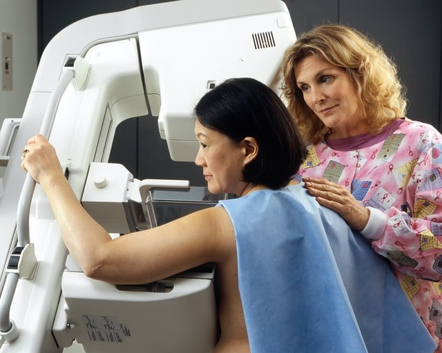 A woman during her breast screening for early breast cancer detection, Breast cancer doctor Hunter Region
